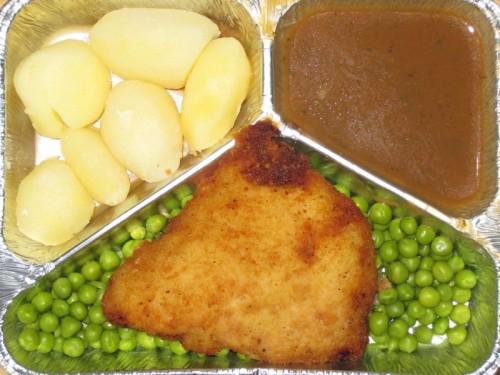 Hähnchenbrust mit Kräuterbutterfüllung, auf Buttererbsen, mit Kräutersoße und Salzkartoffeln